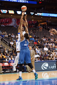 New York's KIA VAUGHN shoots over Minnesota's JESSICA ADAIR.