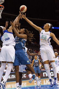 New York's KIA VAUGHN (15) and PLENETTE PIERSON (33) block Minnesota's REBEKKAH BRUNSON'S (32) shot.