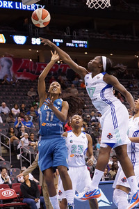 New York's ESSENCE CARSON (17) blocks Minnesota's CANDACE WIGGINS' (11) shot  AS CAPPIE PONDEXTER (23) looks on.
