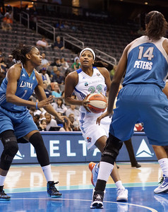 New York's DEMYA WALKER (22) drives to the basket against Minnesota's JESSICA ADAIR (1) AND DEVERAUX PETERS (14).