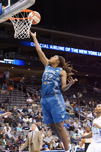 Minnesota's REBEKKAH BRUNSON drives to the basket against the New York Liberty.