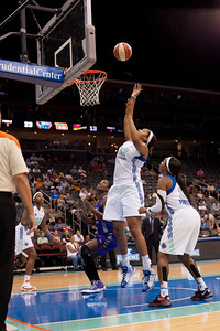 New York's KELLEY CAIN (52) goes up for a basket against the Phoenix Mercury.