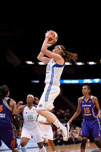 New York's KATELYN REDMON (30) pulls up for a shot against the Phoenix Mercury.