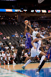 Phoenix's BRIANA GILBREATH (15) takes a jump shot while CAPPIE PONDEXTER (23) attempts to defend the shot for New York.