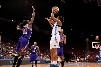 New York's ALEX MONTGOMERY pulls a jump shot over Phoenix's NAKIA SANFORD (43).