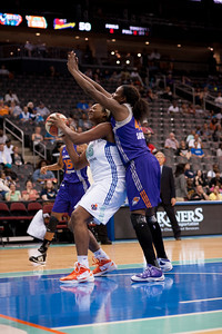 Phoenix's NAKIA SANFORD (43) looks to stop New York's KARA BRAXTON (45) from scoring in the post.