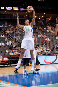 New York's NICOLE POWELL (14) grabs a defensive rebound against the Phoenix Mercury.