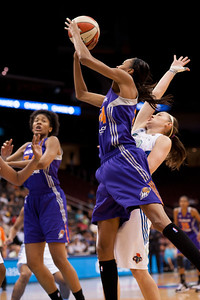 Phoenix's DEWANNA BONNER (24) is fouled by New York's KATELYN REDMON as she attempts a jump shot.