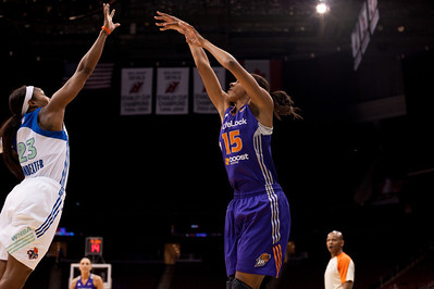 Phoenix's BRIANA GILBREATH (15) follows through on a jump shot over New York's CAPPIE PONDEXTER (23).