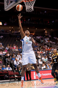 New York's KARA BRAXTON (45) goes up for an uncontested layup in a 94-71 victory over the Tulsa Shock.