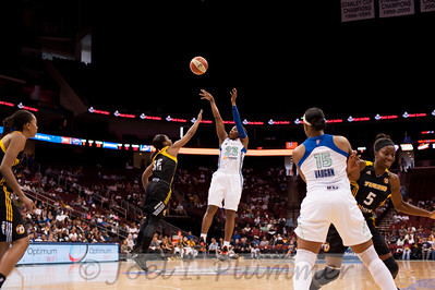 New York's CAPPIE PONDEXTER (23) pulls a fade-away jumper over Tulsa's IVORY LATTA (12).