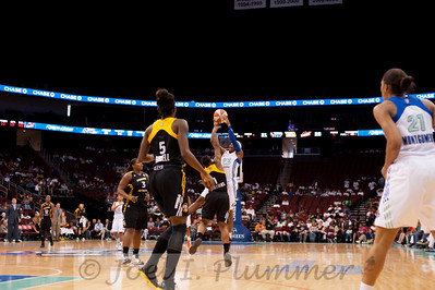 New York's XXXXXXXXX (33) drives past Tulsa's JESSICA ADAIR (1).