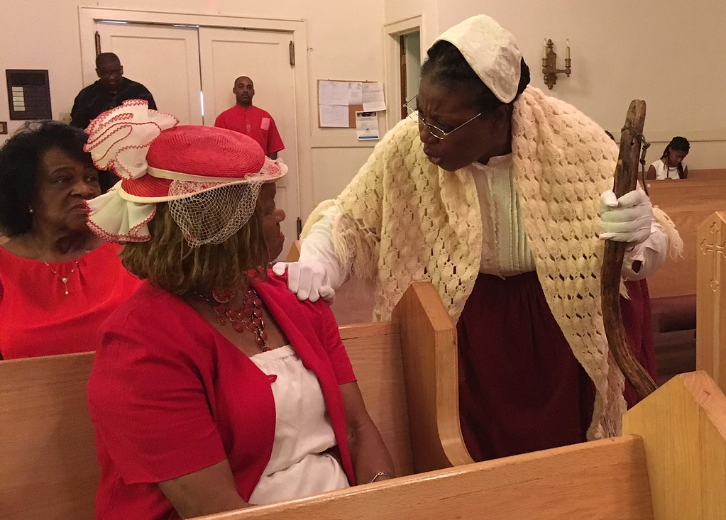 ". Richard Payerchin - The Morning Journal <br> Inez James, center, portrays abolitionist Sojourner Truth as she speaks at the Wesley United Methodist Church Annual Women\'s Day Program on July 16, 2017, at the church, 220 W. Seventh St., Lorain. James was one of three keynote speakers addressing the theme: ""The Leadership & Vision of Women, Past, Present & Future.\"""