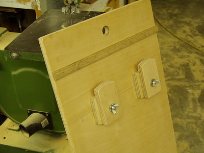 The furring strip fits into the miter slot on the stock table.