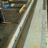 The Angle Iron rail is mounted to the saw and cabinet with bolts and lag screws.