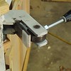 """The locking eccentric is made from a slice of 1-1/2"""" rod with the pivot hole drilled an 1/8"""" off center."""