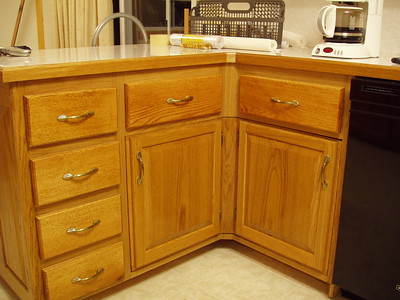 This is the typical corner with the two doors hiding what is usually dormant storage, but,