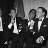 27 Jan 1961, Manhattan, New York, New York, USA --- Jan Murray (L) sits alongside Rat Pack members Dean Martin, Sammy Davis Jr., and Frank Sinatra as the group unwinds backstage at Carnegie Hall after entertaining at a benefit performance in honor of Dr. Martin Luther King Jr. --- Image by © Bettmann/CORBIS