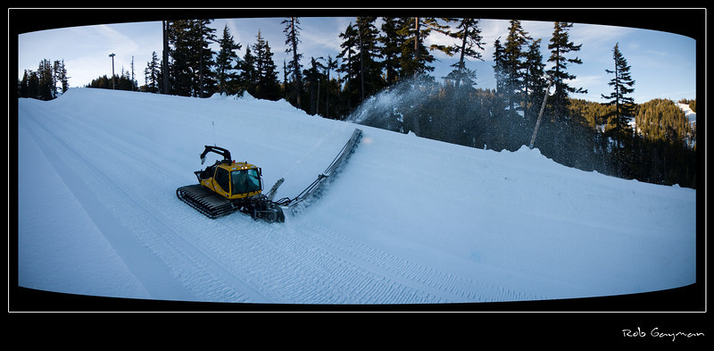 This is Jason cutting the pipe just after the sun dropped below the ridge casting the halfpipe into shadow.  I tried shooting while the sun was still shining on the wall, but the mix of light and dark wasn't working well for me so I waited until full shadow and shot this.<br />  <br /> This is a four shot panorama stitched together in Photoshop CS3.  I wasn't sure how the moving elements of the series would blend together (the cat was moving as well as the spray from the Zaugg), but the 'ol CS3 algorithms did good and it came out both seamless and dramatic, I thought.<br /> <br /> I went for the old-style TV effect with my cropping and framing after discovering that if I'd cropped the shot rectangularly, I would have lost much of what I really liked about this image.  The white border was an add-on since minus it, something was lacking.<br /> <br /> I was tempted to force the whole scene into a higher white balance to warm it, but finally decided the cooler tones (which accurately reflect the scene at the time) contribute nicely to the final 'old TV set' result.<br /> <br /> All in all, I like this photo a lot.<br /> <br /> Lens used: 17-55mm f2.8 IS