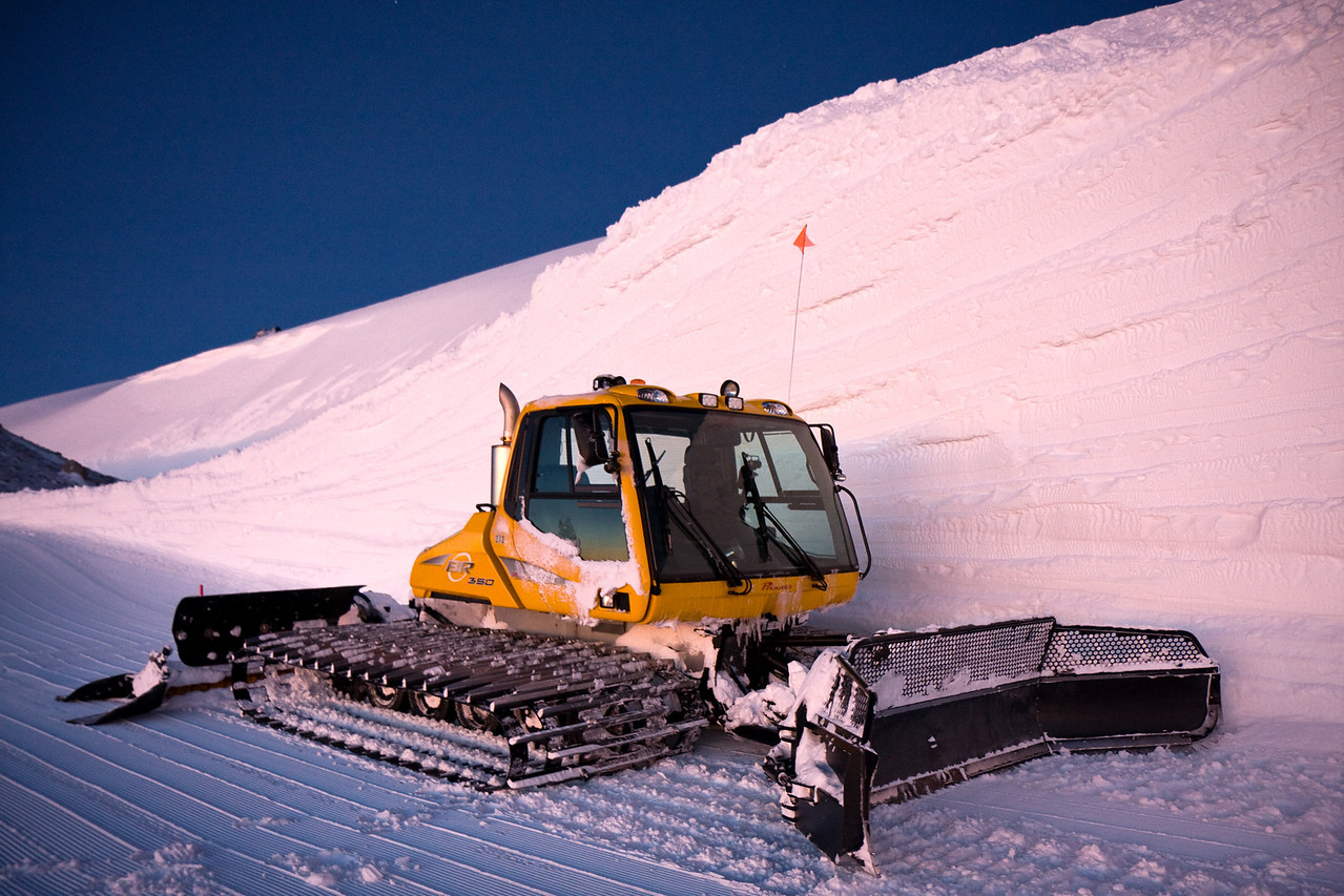 A Prinoth BR350 and a sizable layered cut bank.<br /> <br /> Location: Bottom of Dallas Bowl, Mt. Hood Meadows ski area, Oregon<br /> <br /> Lens used: 17-55mm f2.8 IS