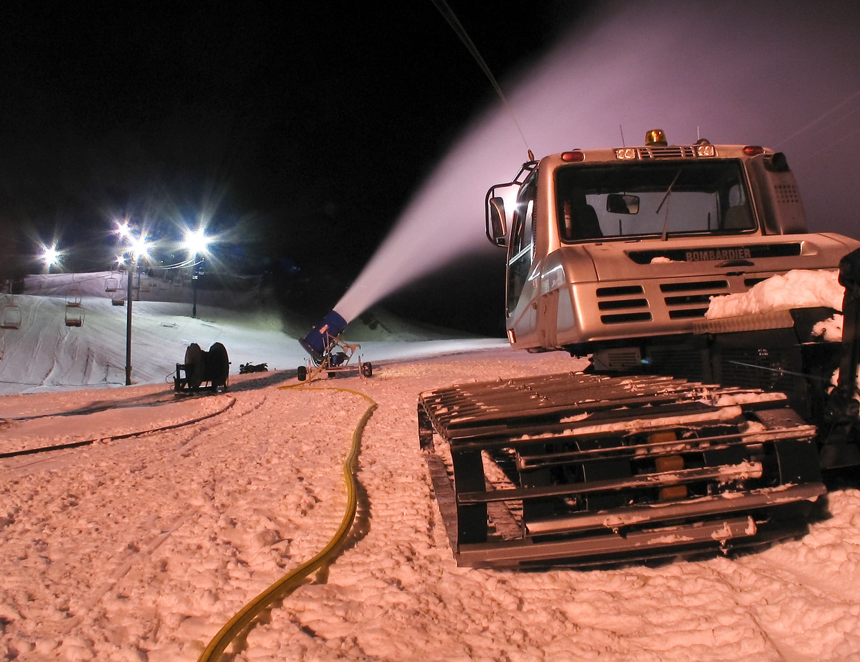 A shot from a few years ago:  Manning the then-single snowgun we had at night.<br /> <br /> Lens used: n/a (Canon S1 IS point-and-shoot)