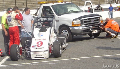 the push track received damage when it drove over the #9 midget of Dave Darland