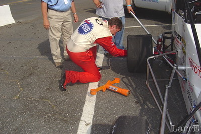 Dave Darland changes the right rear tire after the tow truck drove over it and blew it out.