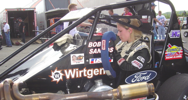 Erica Santos had the #98 midget untill her brother crashed his #4 midget. He took her car for the feature...and won it.