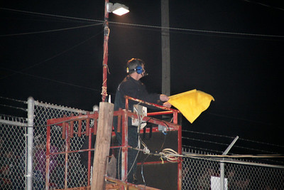 Bruce Coyle is the flagman at Carolina Speedway this year