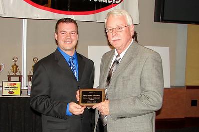 CLINT ELKINS hands STEVE HEINTZ the Supplier of the Year award