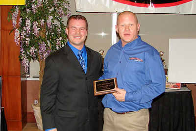 CLINT ELKINS hands JIMMY SMITH Racing Tires their award