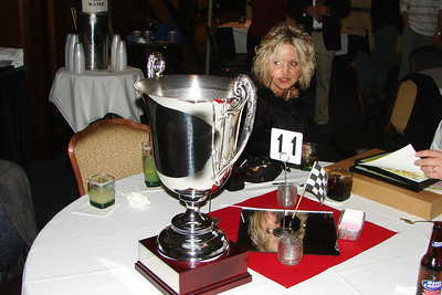 The silver cup shines on Mrs Ricky Weeks.