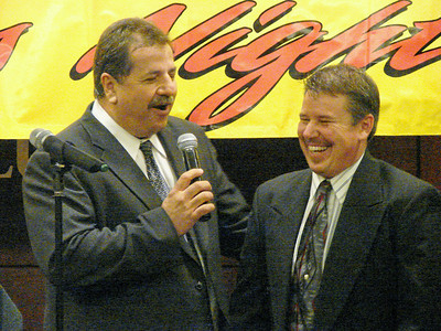 MC for the night Duane Goins  shares a story with Jeff Smith, second place in the points