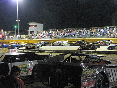cars line up for a feature race
