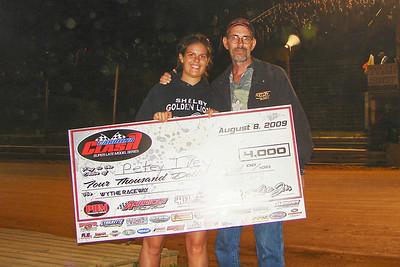 Amanda Beaver and dad show me the money