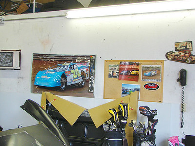 race cars and golf clubs..Kenny enjoys life.