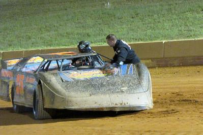 Dean Bowen checks his disabled racer