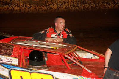 Chris Hargett waits for the hook after his crash in turn one of the crate race