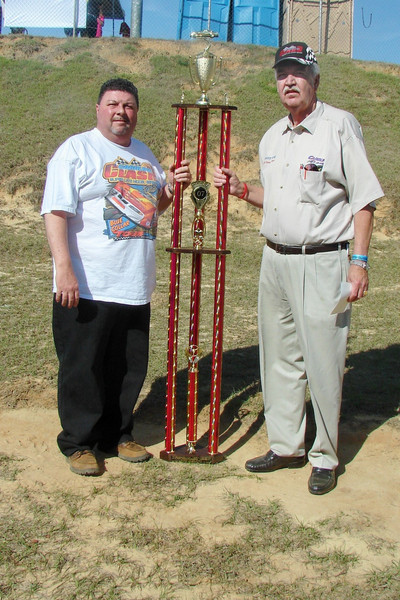 Larry Lee and Larry Long with the Ed Gibbons trophy