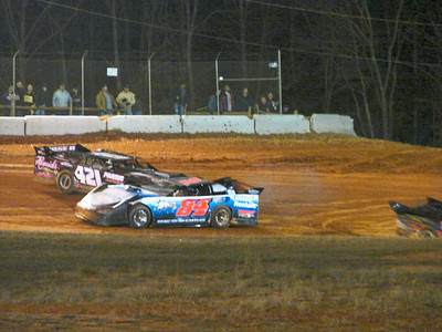 """""""Big A"""" Anthony Sanders and #84 have a meeting in turn 3 during heat races"""