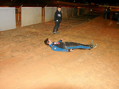 after a poor attempt at a hand stand Chris decided to make snow angels (or is it dirt angels) behind victory circle