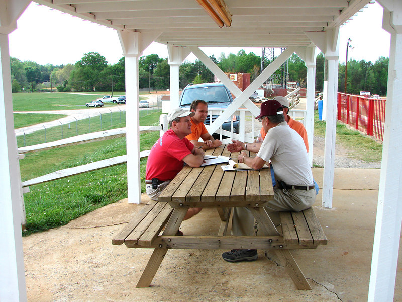 Lowry and Larry Trull are meeting with Mark and Doug, the owners of the Carolina Speedway. It's April 3rd at 4pm and the Skyler Trull race has just been set for August 25, 2007