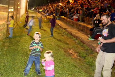 kids play on grass area until the races start.