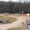 fence will be CLOSED across the old pit entrance road. The pit entrance will be located where the barrel is.