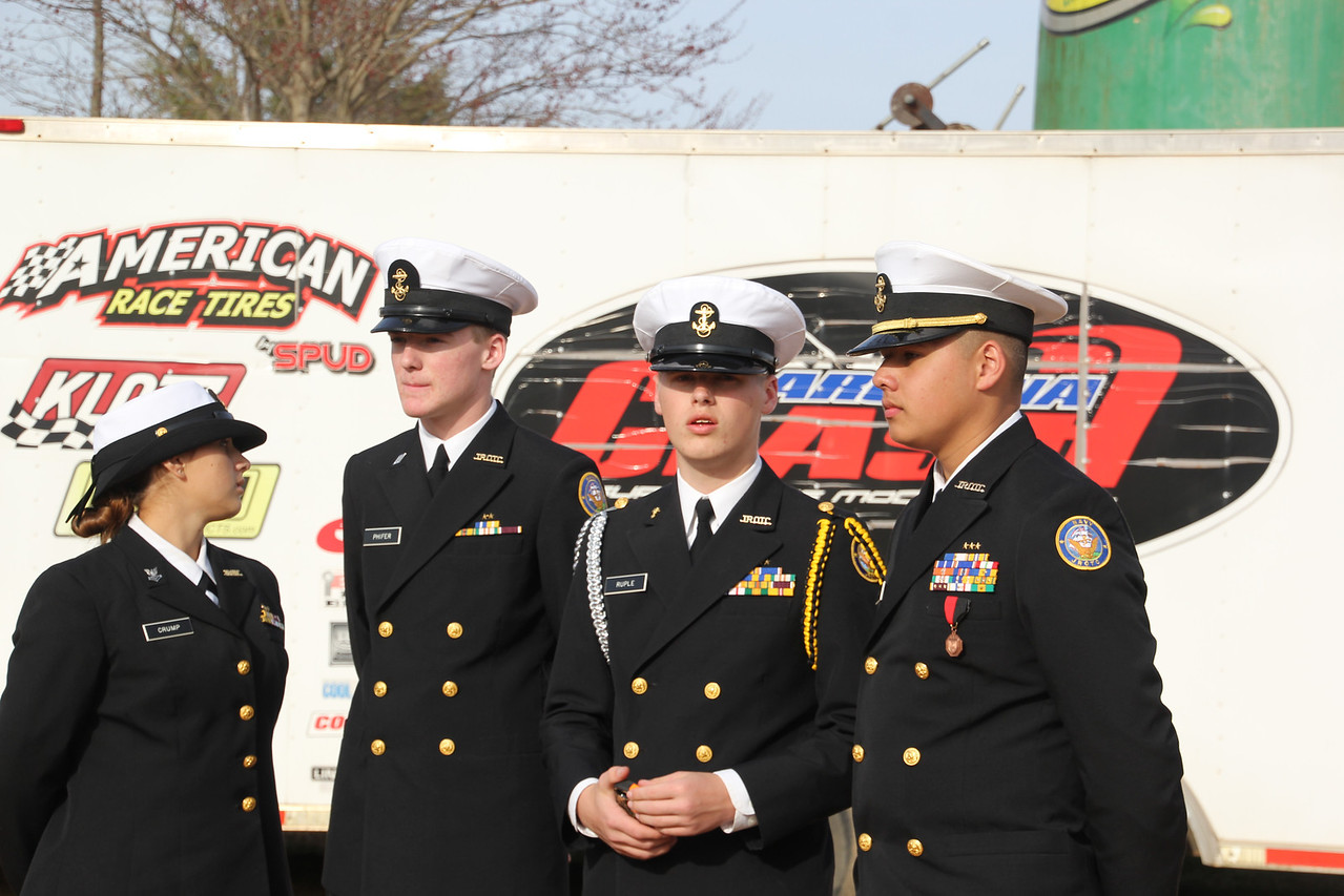 The honor guard for the Skyler Trull Memorial race checks out the cars in the pit area.