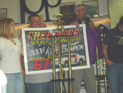Roddy Bolins car owner accepts the 1st place trophy for Limited Sportsman