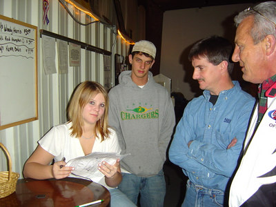 Bruce (the flagman) and Terry Harris watch Britney handle the money