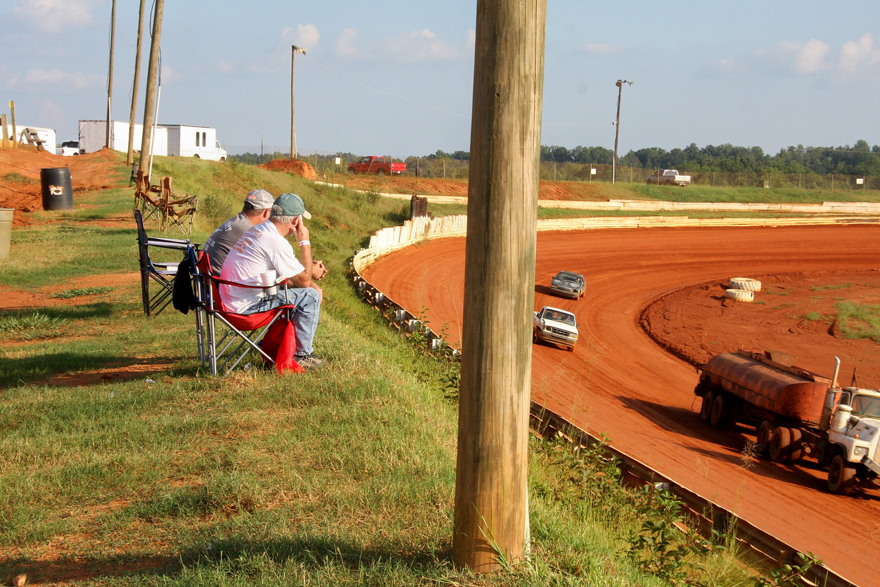 come early and pick your seat. Chairs will line the hill in the pits