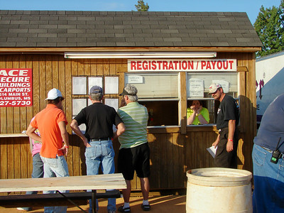 Registration is one end of the concession stand in the pits.