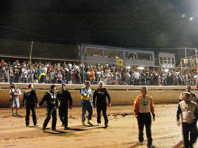 Drivers greet the fans and return to their cars for the 100 lap feature.